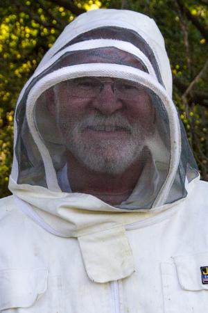 Joe burns in Bee keeper suit.