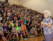 Edie speaks to Otte Assembly in gymnasium