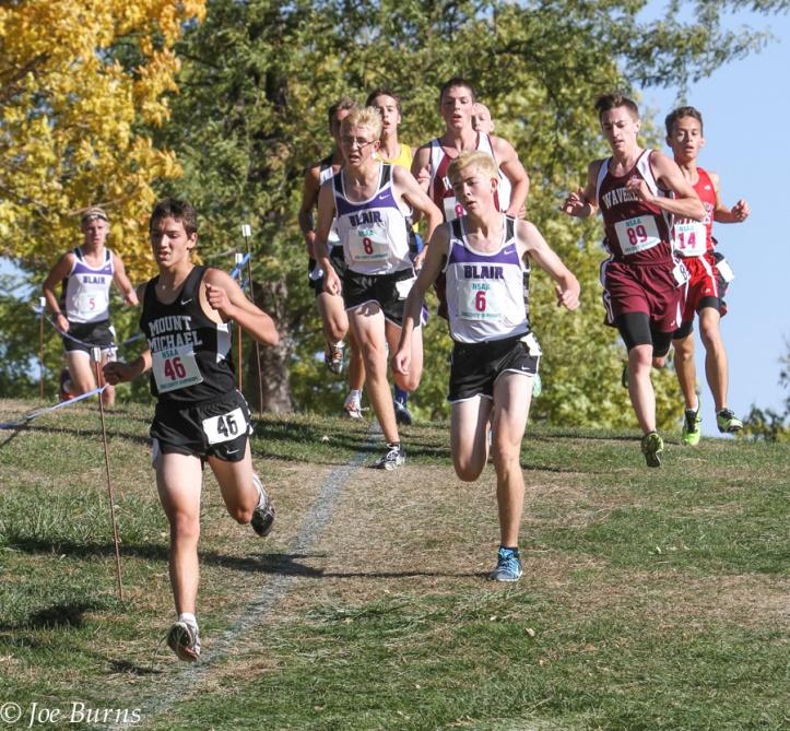 Boys running downhill