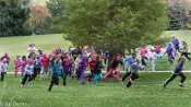 girls running past trees