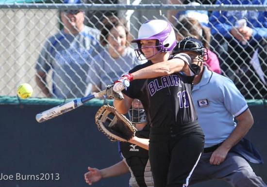 girl at bab hits ball