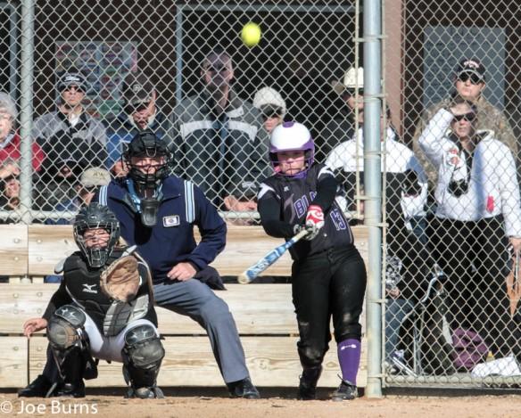 girl hits home run