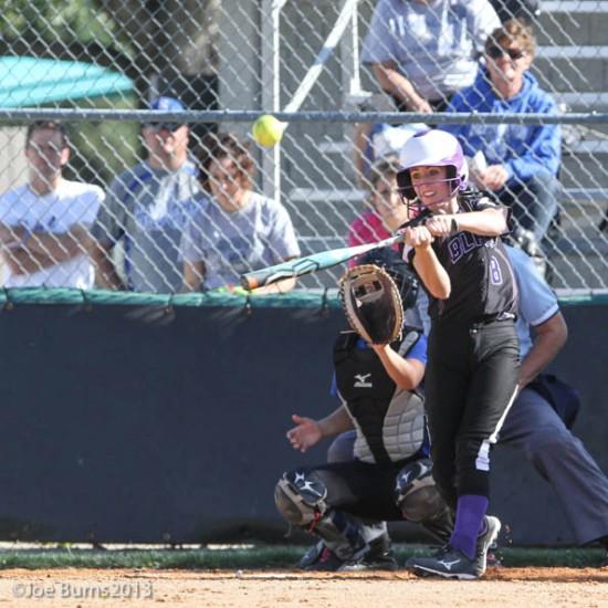 girl hits baseball