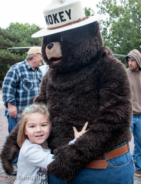 Girls hugging Smoley Bear