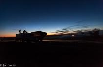 Silohette of an standing on grain trailer