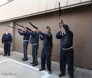 Soldiers fire rifles