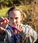 girl withn scissors cutting stem