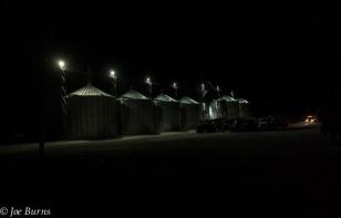 Row of grain bins at night,