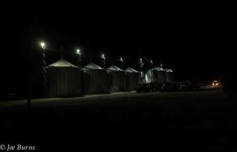 Row of grain bins at night,