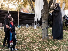 thre kids and tall persob in robbed death costume.