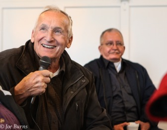 smiling man with microphone