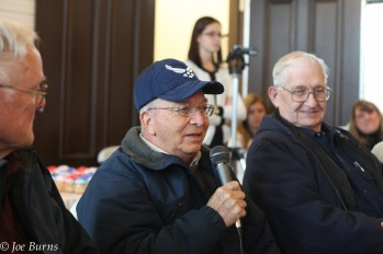 man in cap with microphone