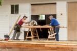 Men sawing lumber.