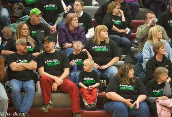 Both Arlington and Wahoo basketball fans wore black and green Mason Possible tee shirts during the Arlington and Wahoo basketball games.