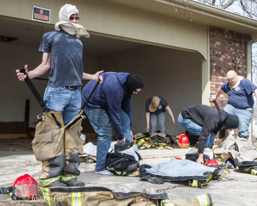 Firefighters Kevin Dunklau, Nick Shotwell, Jimmy Schollmeyer, Briana Cudly,and Jeff Hasenauer practice putting on all of their protective gear clothing and gear in less than a minute.