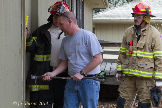 Instructor  Tom Christiansen with help of  Riley shoenfelder demonstrates a forced entry technique.