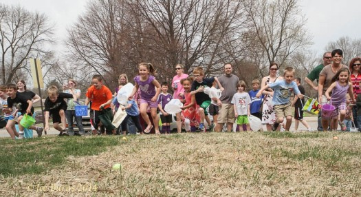 First and second graders dash for the eggs.