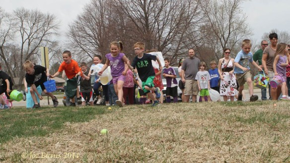 First and second grade kids run for eggs.