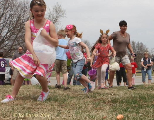 First and second graders look for their share of the 2500 plastic Easter eggs.