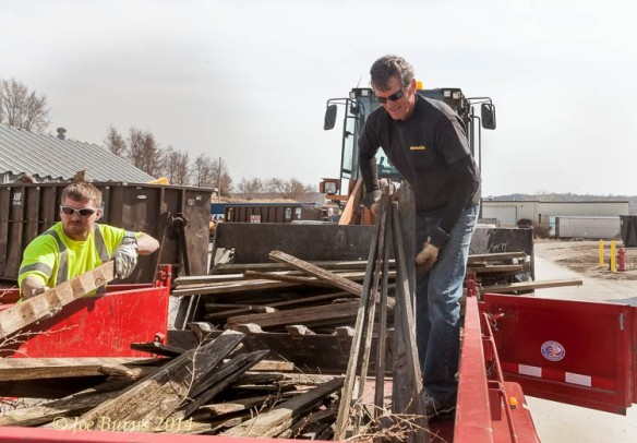 Jesse Johnson assists Bobby Rand unload a old fence lumber at the Blair Public Works yard at Third Avenue and Colfax.