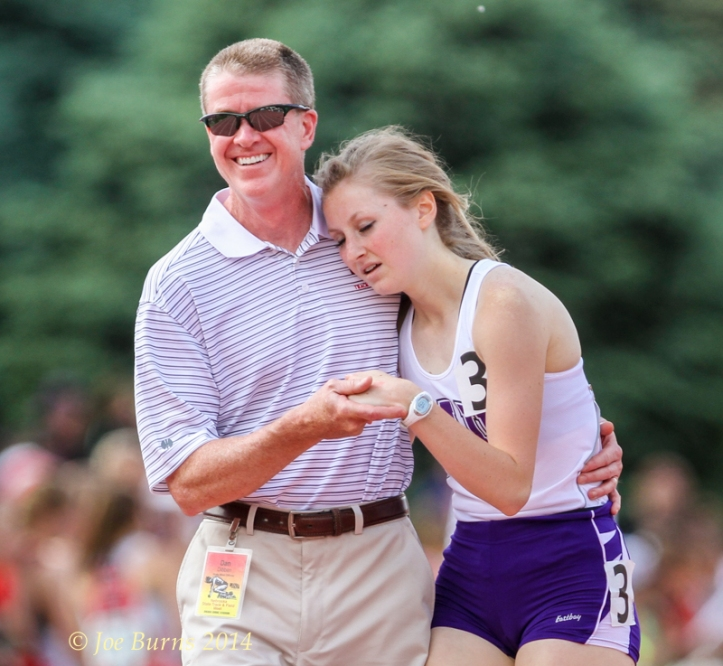 Don Dibben gives daughter  Molly Dibben a hug and support following the class B Girls 4-by-400 relay.  The Blair girls placed fourth in the state competition.