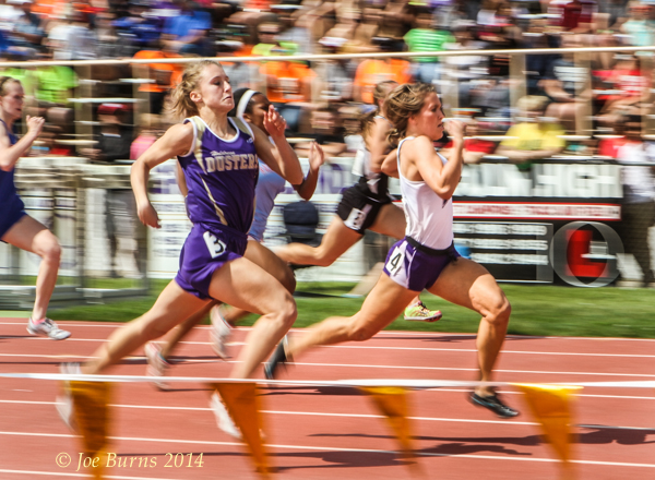 Morgan Anderson streaks toward the finish line to win the Class  B 100 preliminary race. at the State Track and Field Championships.