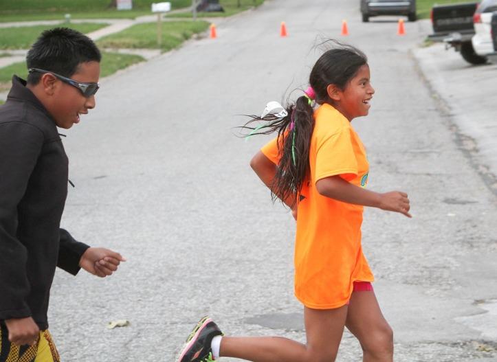Bradley and Maria Tonn run toward the finish line.