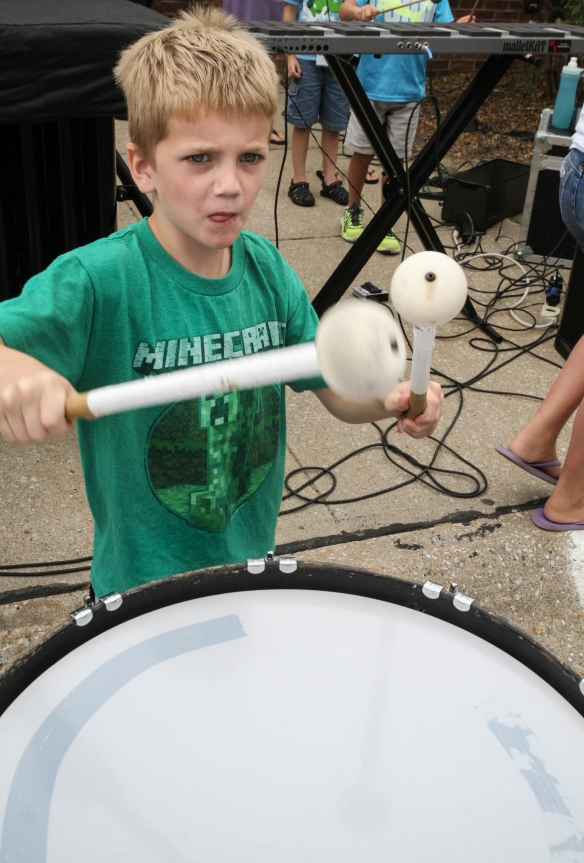 Chase Cottle bangs on a drum.