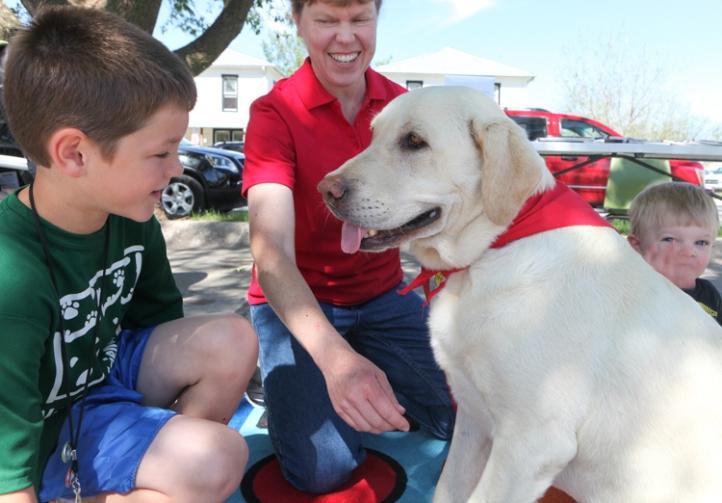 Gavin Beal greets Tacoma the therapy dog.