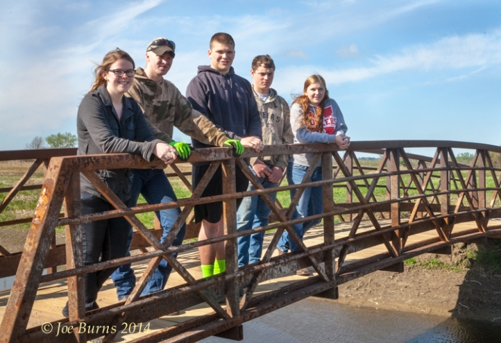 From left, Kristina Campell, Grant Kubie, Casey Harper, Edgar Deshong, and Ashlyn Johnston stand on a renovated footbridge on the Green Heron Environmental Education Trail.  The bridge had previously spanned a creek on a trail that was abandoned due to flooding.