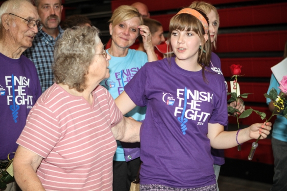 Gerald Kobs, left, Donna Kobs, Ann Kobs, and Brooke Kobs walk during the survivor lap Saturday at Relay for Life.  Brooke and Gerald are cancer survivors.