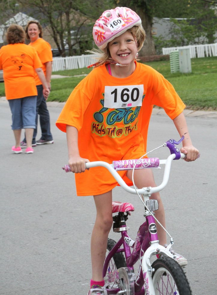Olivia Parsons bikes with a smile.