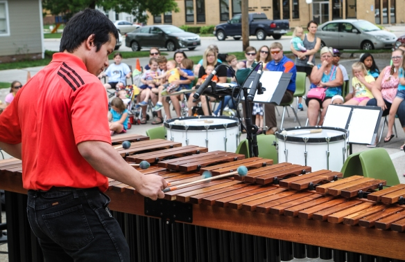 Raymond Ryan plays a marimba solo for the audience gathered in the Blair library parking lot.