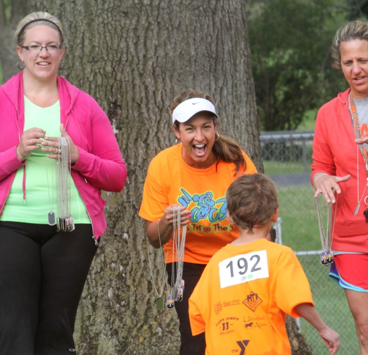 Amy Rogers greets Silas Bush at the finish line.