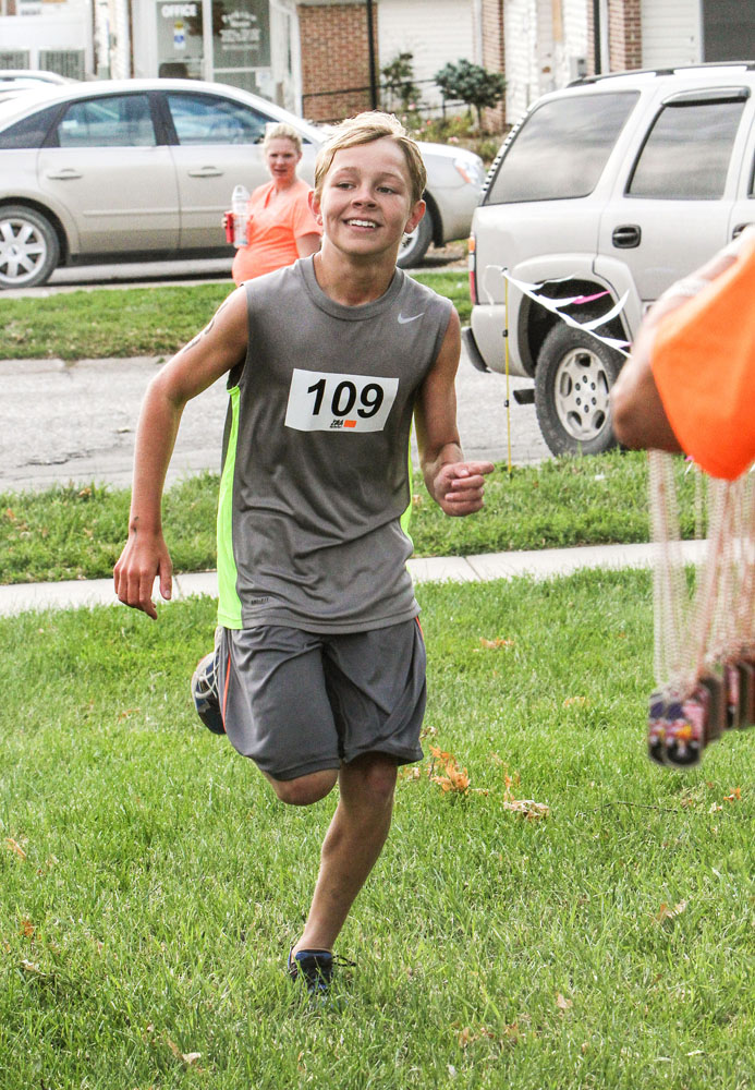 Sam Lueders was the first to finish the triathlon in 24 minutes. The competitors were not officially timed.