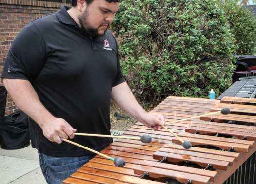 Percussion instructor Scott Shinborn plays a marimba solo .