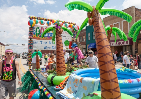 St. Mary Episcopal Church floatpasses along Washington Street during the Gateway Parade Saturday.   Beach Party was the parade theme.
