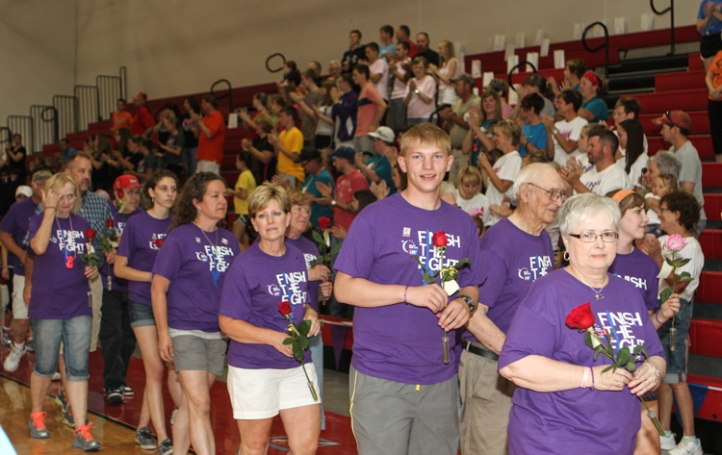 Cancer survivors walk together during the survivor lap.