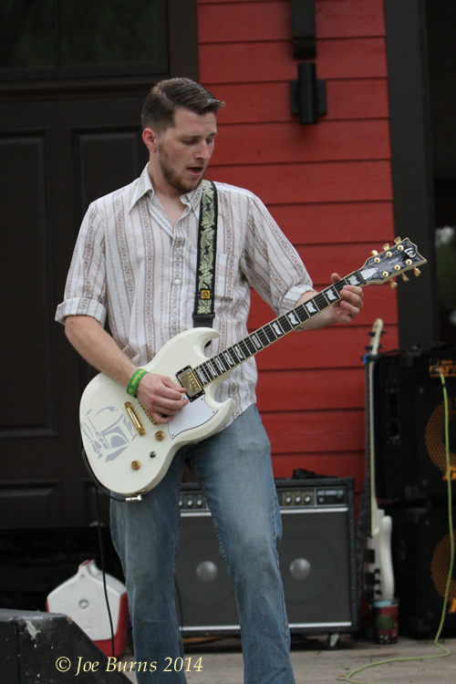 Tanner Ashland plays guitar with Mulligan Stu Friday.