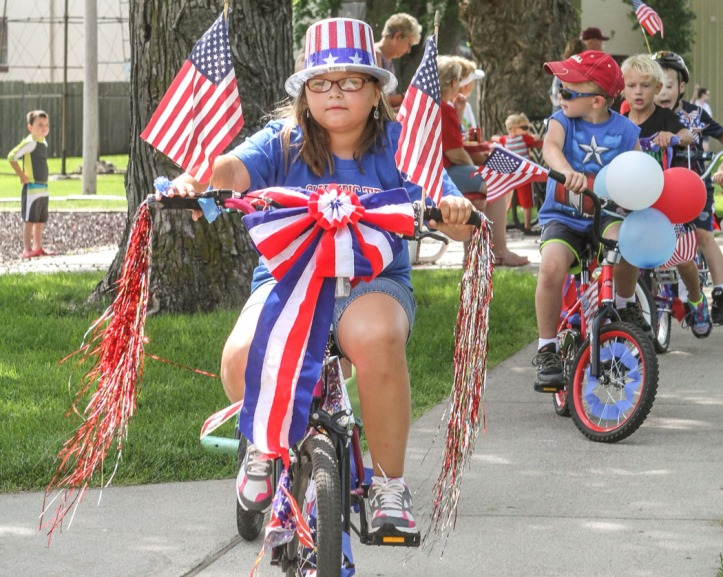 Carissa Brazelton rides her decorated bike in the kiddie bike parade.