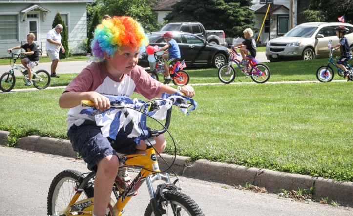 Kiddie parade bike rider.
