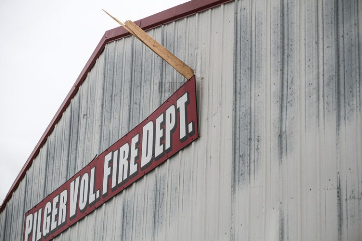 Wooden timber lodged in the exterior wall of the Pilger Volunteer Fire Department station.