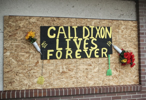 A memorail to 5-year-ole Cali Dixon, who was killed in the storm, hangs on th outside of the  Pilger Public Library.