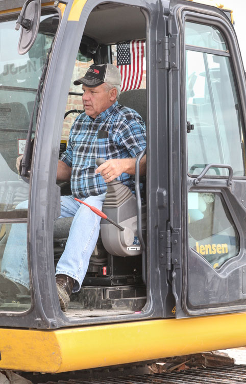 Gary Koehlmoos of Pilger tears down the old co-op building in Pilger.  He has been responsible for tearing down a majority of the buildings in the business district.