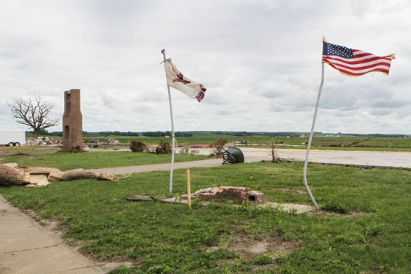 Nothing left of the Lutheran church except the flags and bell.