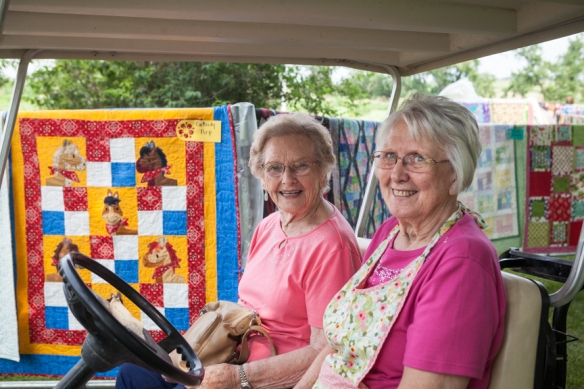 Darlene Harper gives a visitor a tour of the quilt show.