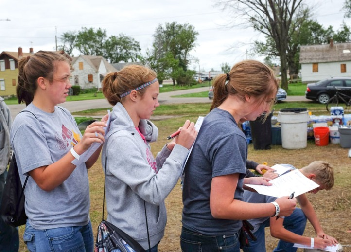 Arlington students fill out liability waivers.