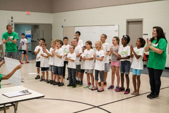 Camp Invention campers give a cheer  during the final session when the kids showed off their creations to parents.