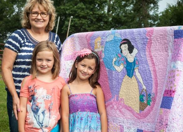 Quilter Lori Lang with grand daughters Lilly and Savannah Lang