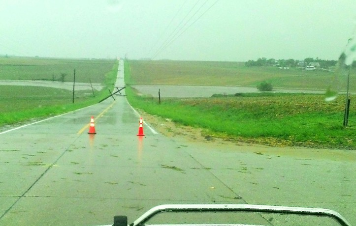 Power poles destroyed in June 3 storm alonc county road 4 near County Line road. (Courtesy Stacie and Myron Poessnecker.)